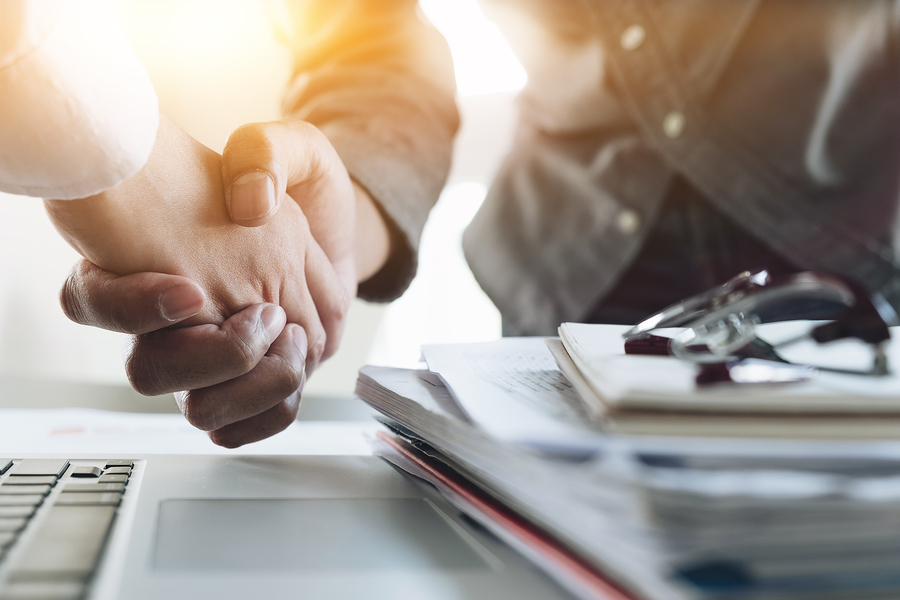 customer shaking hands business deal
