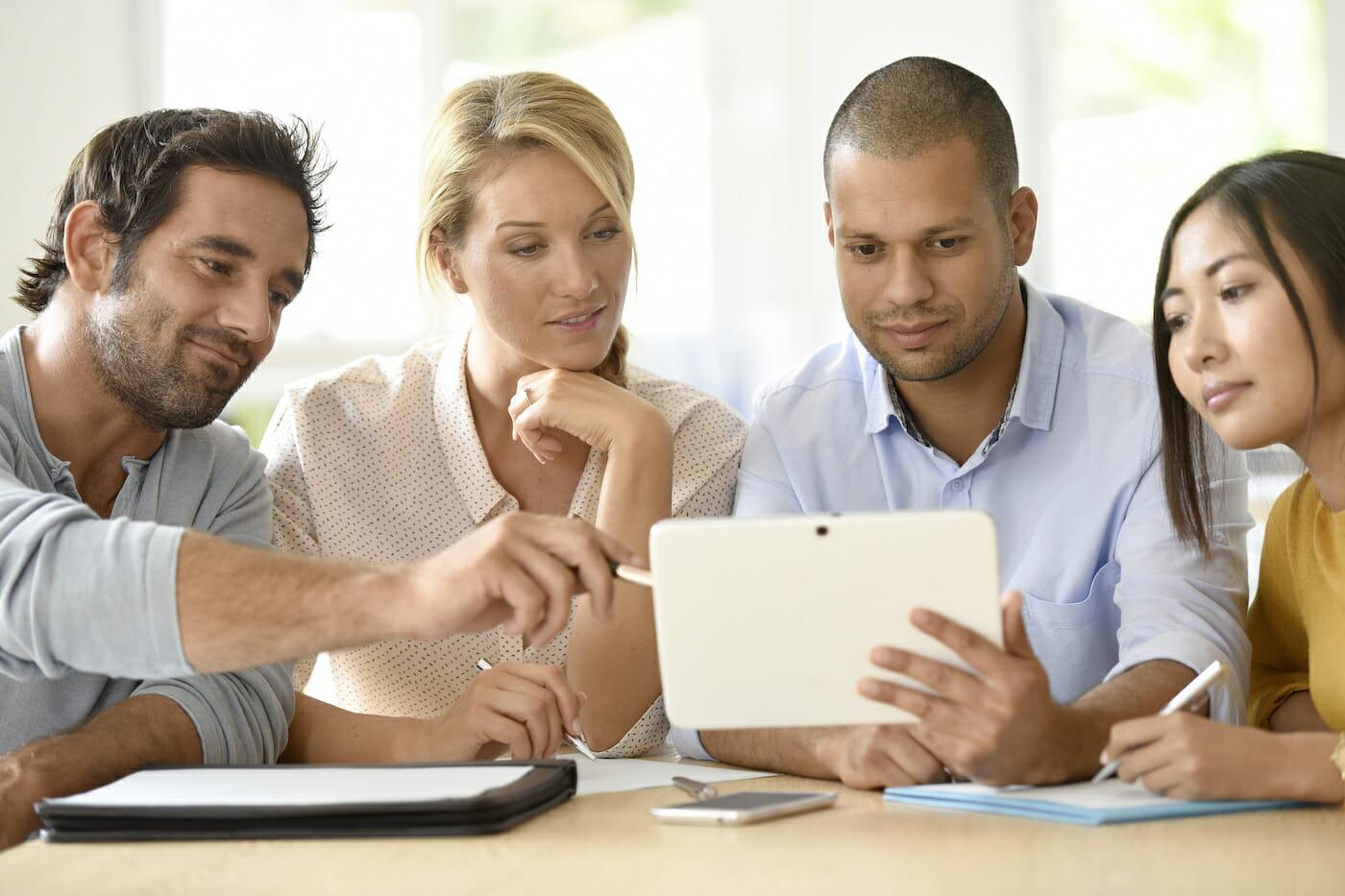 team looking at website